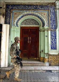 Soldier guarding market in Iraq