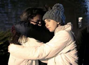 Group hugging at VT service