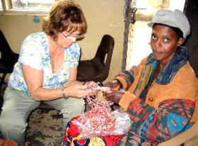 Kathi Winter and Ugandan woman