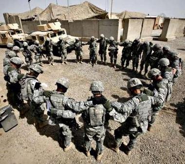 U.S. soldiers pray before patrolmission