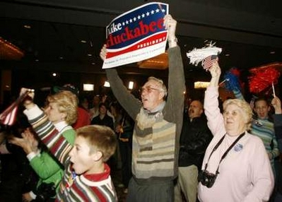 Mike Huckabee supporters celebrate