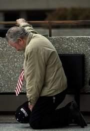 Man prays in Detroit